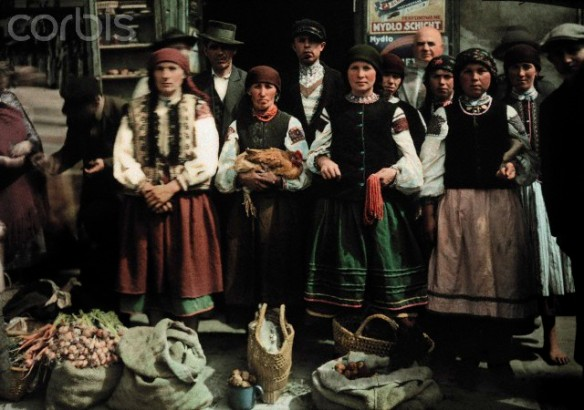 ca. October 7, 1930, Poland --- Women and men stand in front of their goods to sell at the market --- Image by © Hans Hildenbrand/National Geographic Society/Corbis
