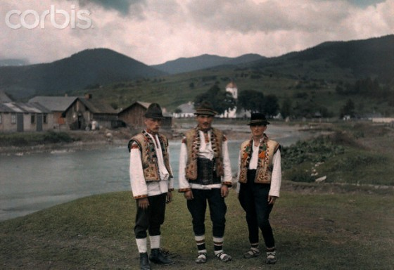 1927 --- Three men pose in popular Ruthenian costume of embrodiered vests --- Image by © Hans Hildenbrand/National Geographic Society/Corbis