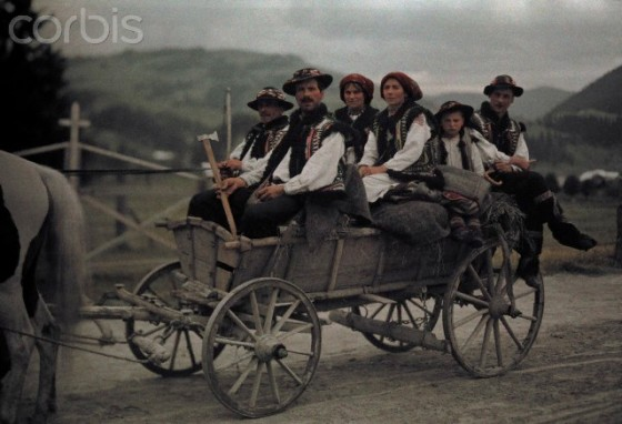 ca. October 7, 1930, Poland --- A group of people ride in a cart on their way to church --- Image by © Hans Hildenbrand/National Geographic Society/Corbis