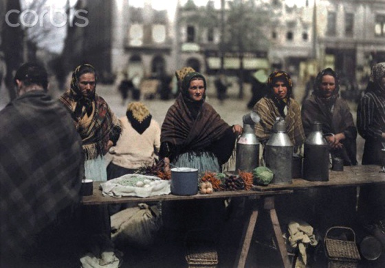 ca. October 7, 1930, Krakow, Poland --- Women sell milk and vegetables at a market --- Image by © Hans Hildenbrand/National Geographic Society/Corbis